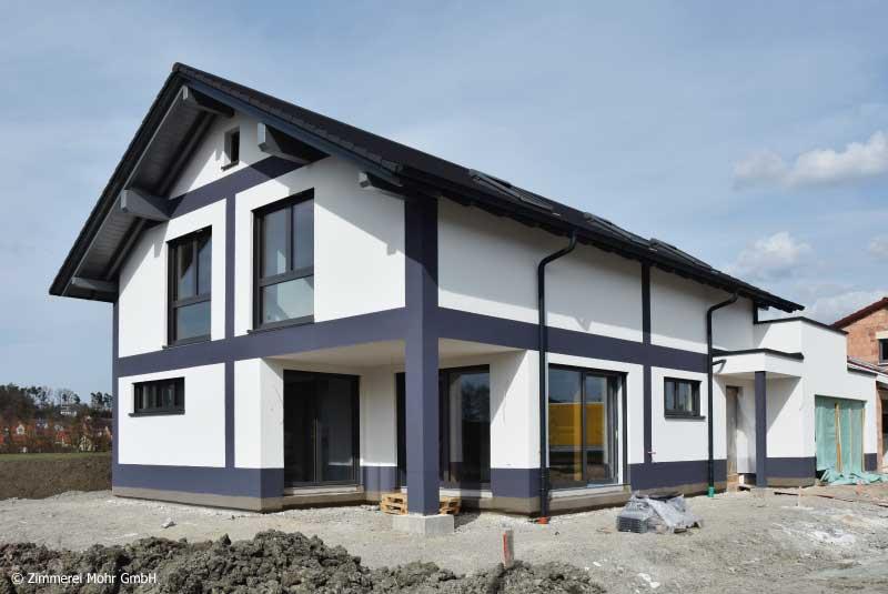 Einfamilienhaus DESIGN - Neubau Holzhaus mit Putzfassade und Satteldach Weihenzell