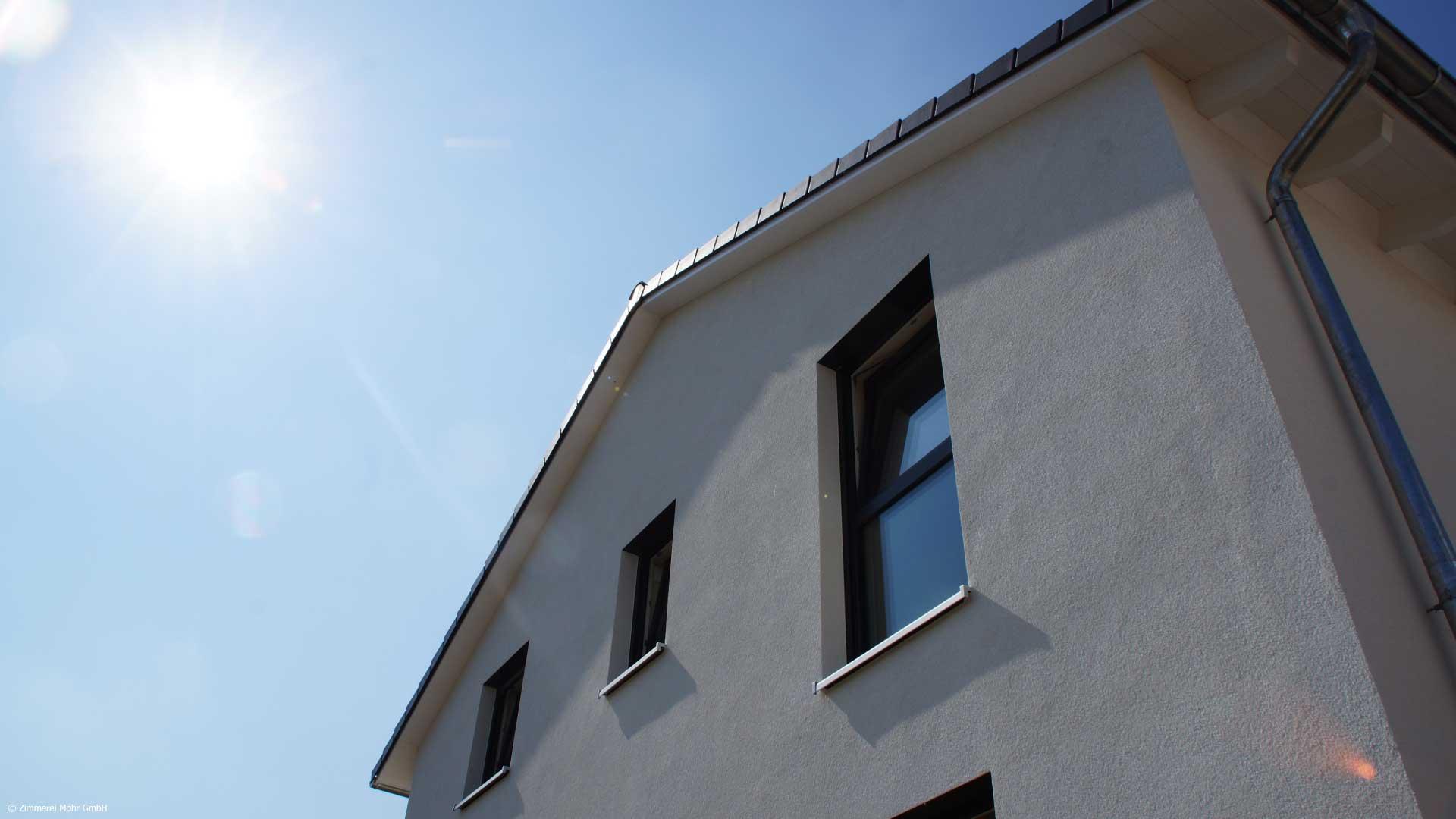 Einfamilienhaus NEO – Klassisches Holzhaus mit Putzfassade